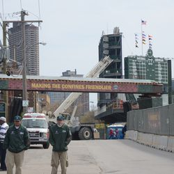 11:46 a.m. Crane on Waveland being relocated before the game -