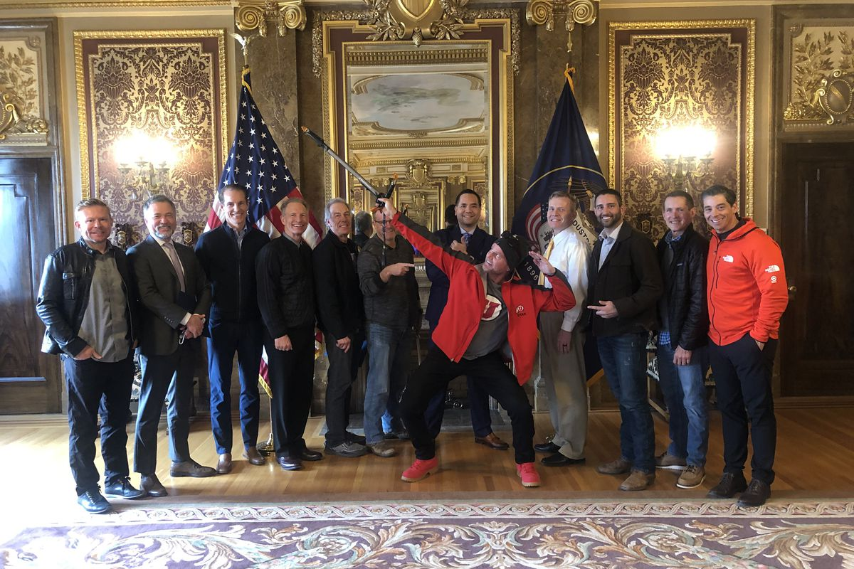 Don Cash, center in the red coat, is pictured with others during a send-off for his trip to Mount Everest in Utah Attorney General Sean Reyes' office.