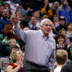 Former Utah Jazz coach Jerry Sloan acknowledges the crowd as they applaud after it was announced that a banner with his name will be hung from the rafters with other Jazz greats Dec. 9, 2013.
