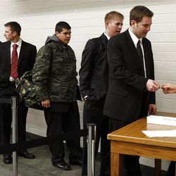 Missionaries begin processing on their first day at the Provo Missionary Training Center of The Church of Jesus Christ of Latter-day Saints in Provo, Utah, Wednesday, Feb. 2, 2011.