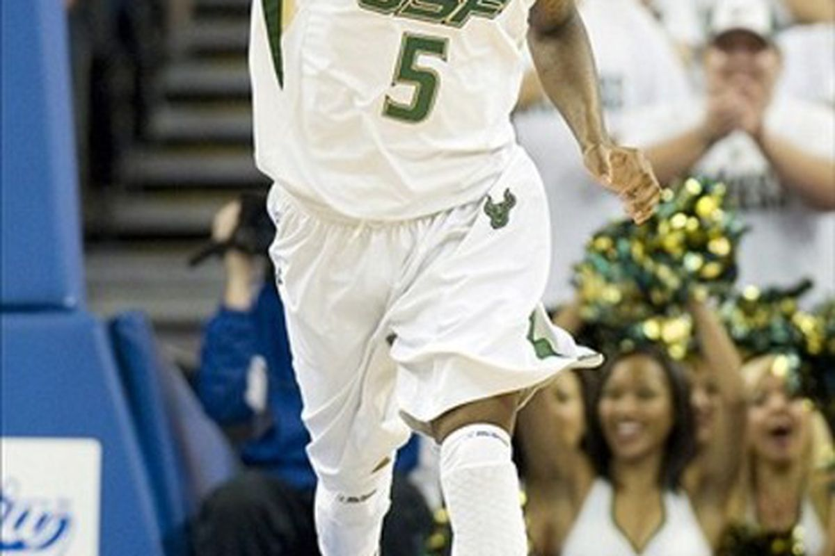 March 3, 2012; Tampa, FL, USA; South Florida Bulls guard Jawanza Poland (5) reacts after scoring a basket against the West Virginia Mountaineers at the Tampa Bay Times Forum.  Mandatory Credit: Jeff Griffith-US PRESSWIRE