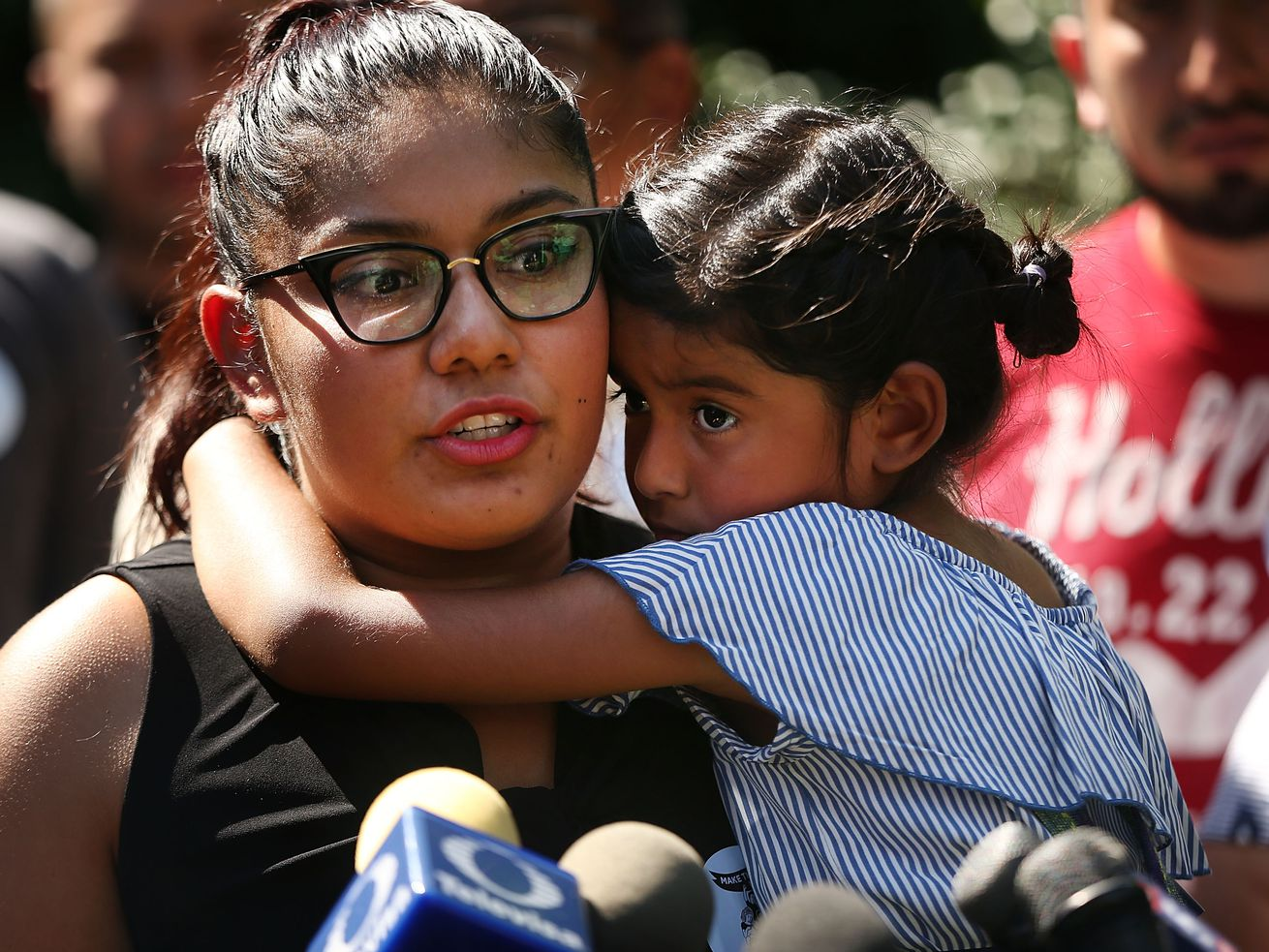 Perla Silva holds her daughter Aileen at a news conference for her parents Concepcion and Margarito Silva, who were detained by Immigration and Customs Enforcement on the Fourth of July in New York City.