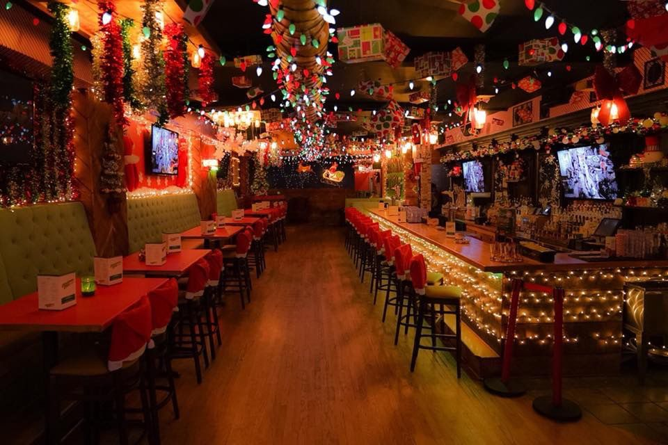 A long bar with lots of Christmas decorations.