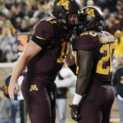 Minnesota quarterback Max Shortell, left, and running back Donnell Kirkwood celebrate Kirkwood's rushing touchdown in the second half of an NCAA college football game against Syracuse in Minneapolis on Saturday, Sept. 22, 2012. Minnesota defeated Syracuse 17-10.