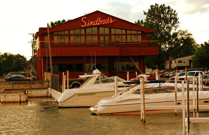 The red exterior and sign at Sindbad's overlooking the marina.