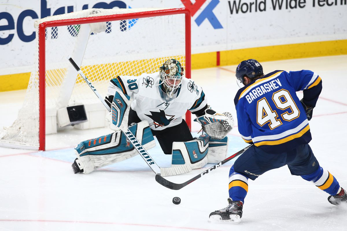Mar 27, 2018; St. Louis, MO, USA; St. Louis Blues center Ivan Barbashev (49) skates in for a shot against San Jose Sharks goaltender Aaron Dell (30) during the third period at Scottrade Center. The Blues won 3-2 in overtime.