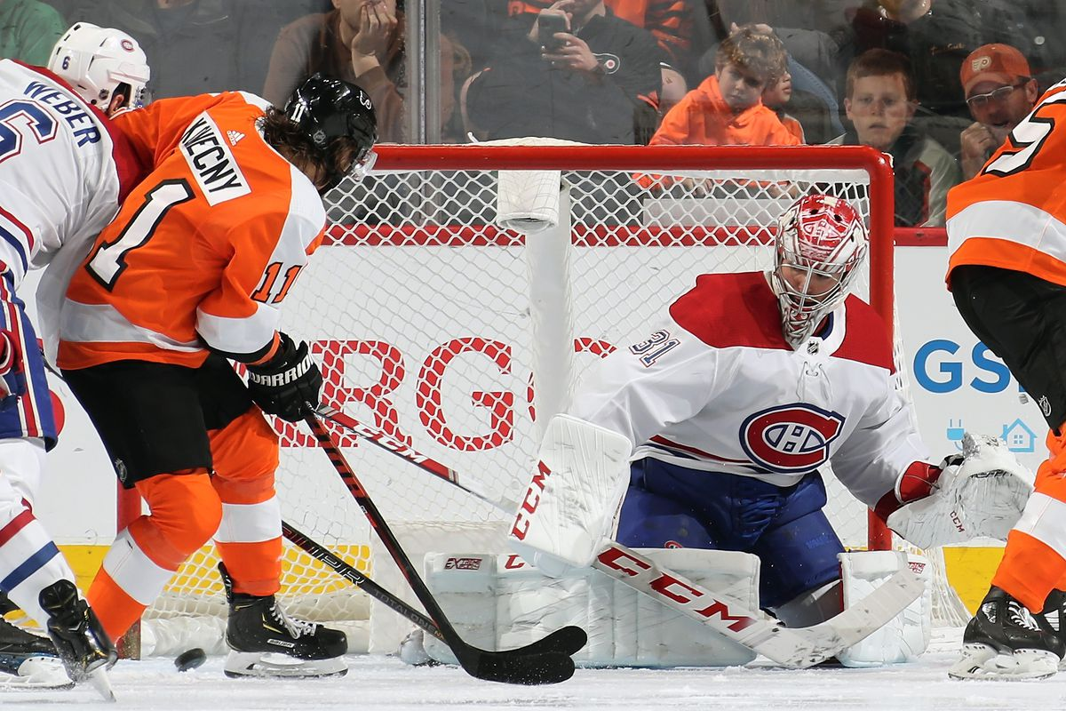 Carey Price and Shea Weber of the Montreal Canadiens react to a shot on goal by Travis Konecny of the Philadelphia Flyers on January 16, 2020 at the Wells Fargo Center in Philadelphia, Pennsylvania.