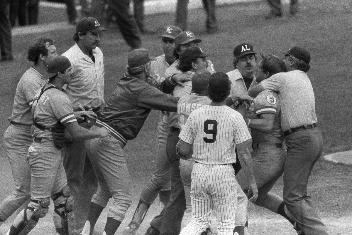 In this July 24, 1983, file photo, Kansas City Royals' George Brett, second from right, is restrained by umpire Joe Brinkman after his bat was ruled illegal because of pine tar beyond the legal limit.
