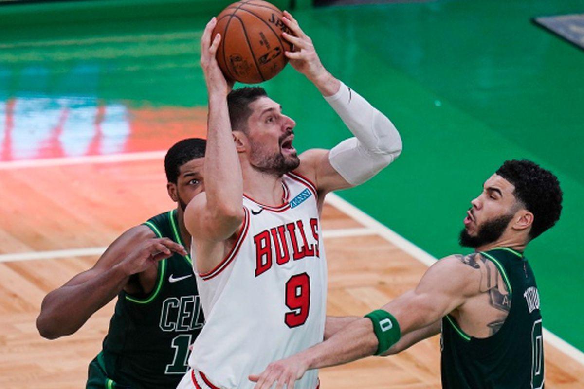 The Bulls' Nikola Vučević goes up for a shot against the Celtics.