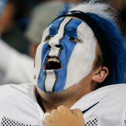 A fan cheers as BYU and Arizona State compete during an NCAA college football game at LaVell Edwards Stadium in Provo on Saturday, Sept. 18, 2021.