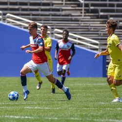 Benjamin Redzic (11) dribbling during the opening match of the 40th Annual Dallas Cup.