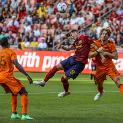 Real Salt Lake midfielder Damir Kreilach (8) battles Houston Dynamo defender Tim Parker (5) for the ball as RSL and Houston play an MLS soccer game at Rio Tinto Stadium in Sandy on Saturday, June 26, 2021.