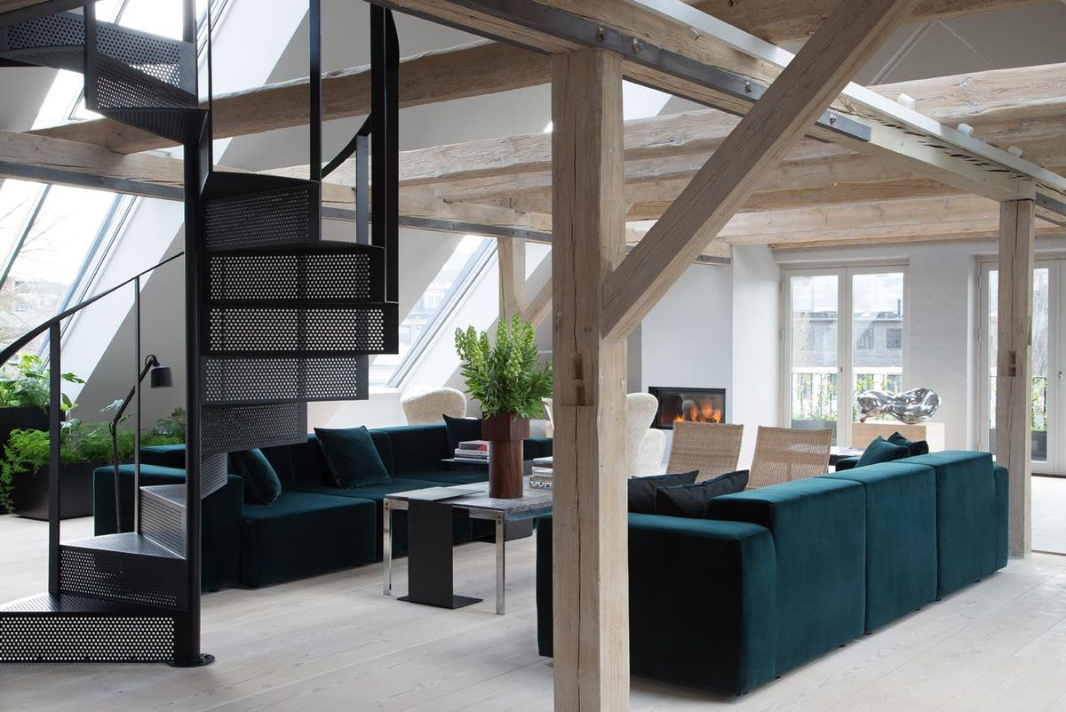 Green couches in loft space