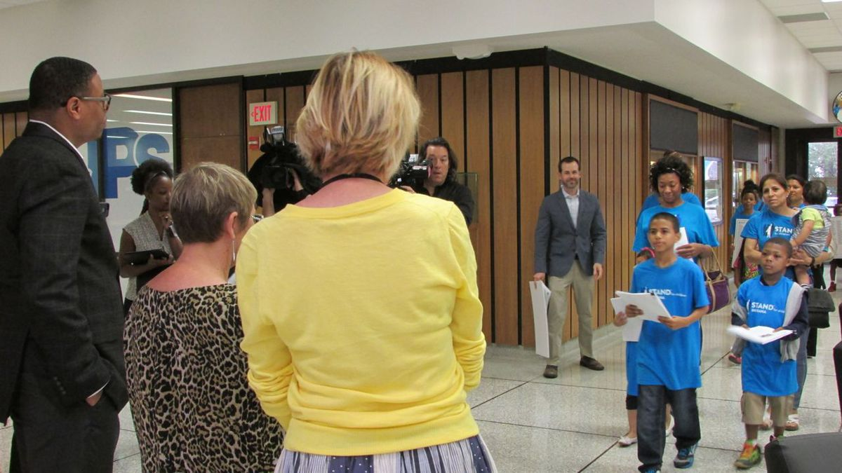 Parents affiliated with the group Stand For Children delivers 1,000 signatures calling for changes in IPS to Superintendent Lewis Ferebee and IPS board members Diane Arnold and Mary Ann Sullivan.
