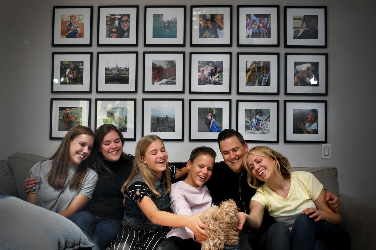 """Eve McKeown, 16, Grace, 18, Esther, 12, Jack, 15, Greg, 43, and Anna, 45, pose for a family portrait with their dog, Winston, in Calabasas, California, on Saturday, May 1, 2021. Greg McKeown's latest book, """"Effortless,"""" came out last week."""