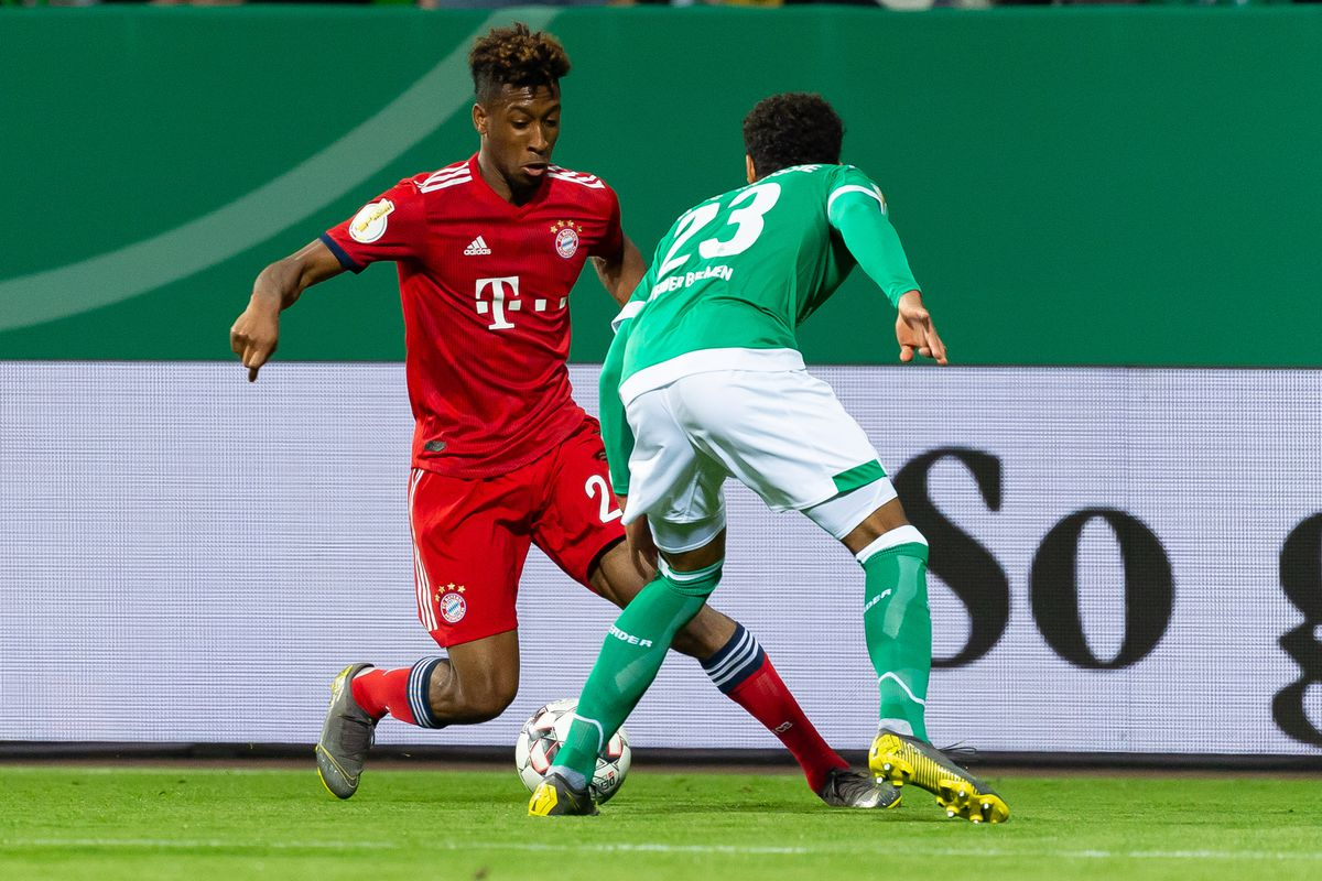 BREMEN, GERMANY - APRIL 24: Kingsley Coman of FC Bayern Muenchen and Theodor Gebre Selassie of SV Werder Bremen battle for the ball during the DFB Cup semi final match between Werder Bremen and FC Bayern Muenchen at Weserstadion on April 24, 2019 in Bremen, Germany.