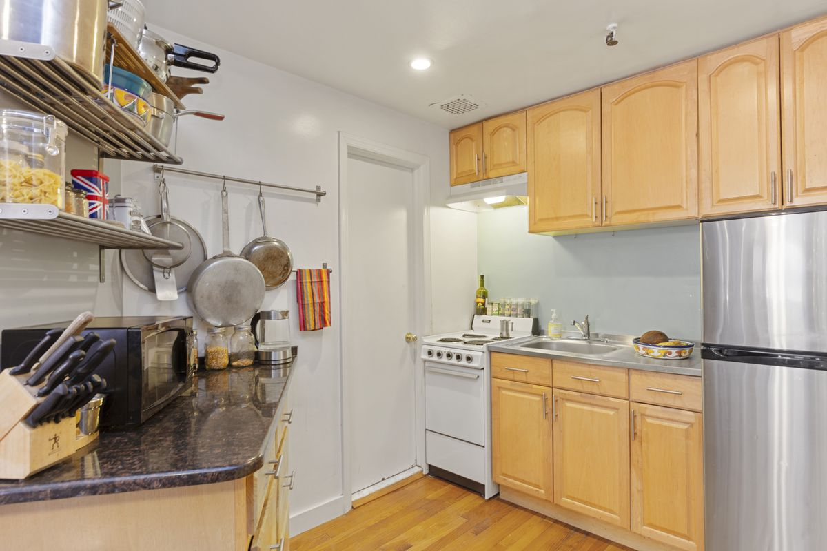 A small kitchen with wood cabinetry.