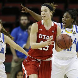 Utah's Michelle Plouffe (15) looks to pass as UCLA's Kari Korver (2) and Jasmine Dixon, right, look on during the first half of an NCAA women's college basketball game in the Pac-12 Conference tournament, Friday, March 8, 2013, in Seattle. (AP Photo/Ted S. Warren)