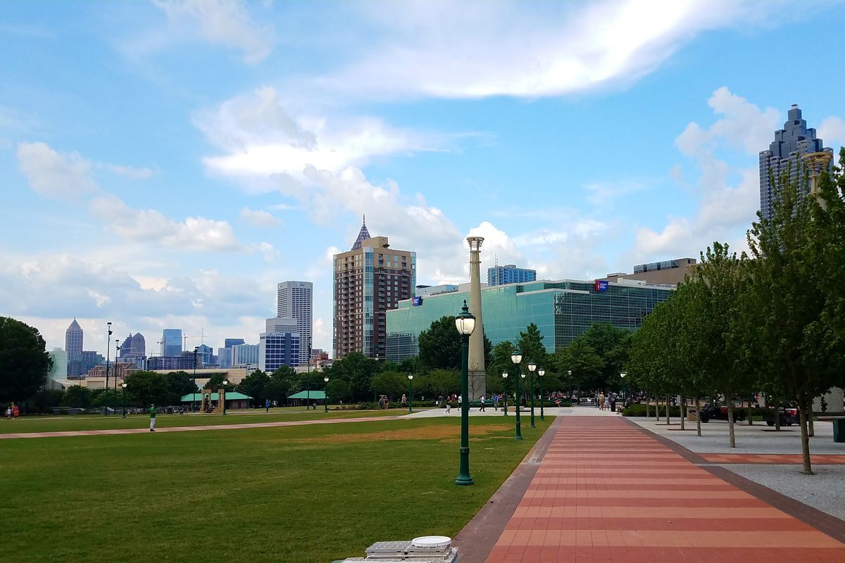 The park's expanded views to Midtown, with the Metro Atlanta Chamber building now razed and a new section of lawn rooted.