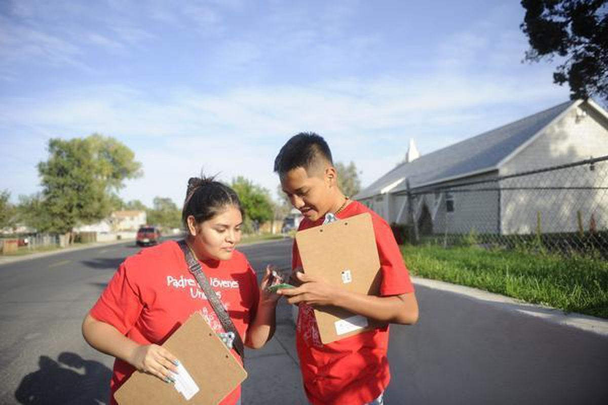 Valeria Cordova and Alex Duran with Padres & Jóvenes Unidos conduct a get-out-the-vote effort in 2013, encouraging voters to cast ballots but not advocating for a position.