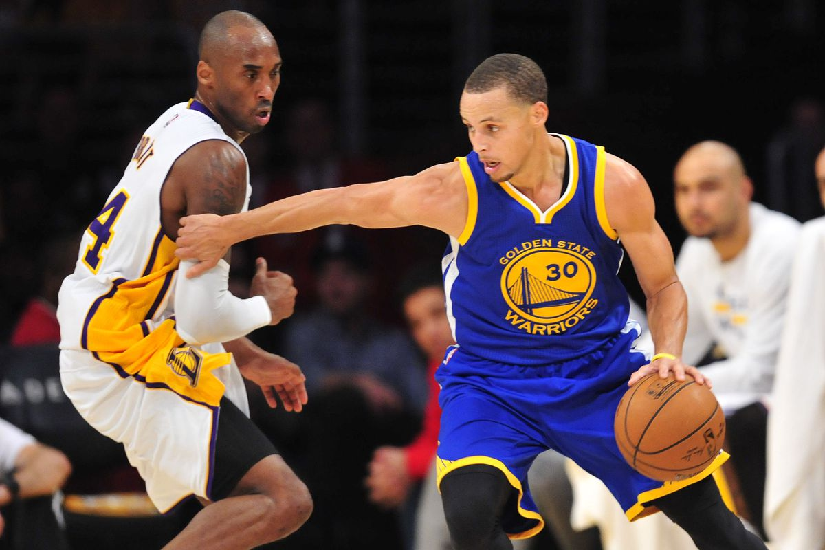 Stephen Curry drives past Lakers guard Kobe Bryant