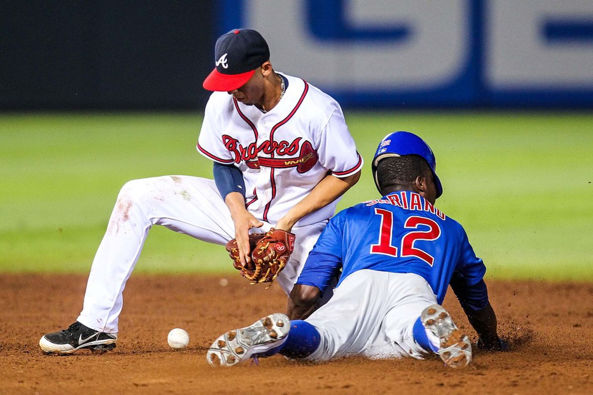 Atlanta, GA, USA; Chicago Cubs left fielder Alfonso Soriano steals second base safely as Atlanta Braves shortstop Andrelton Simmons bobbles the throw at Turner Field. Credit: Daniel Shirey-US PRESSWIRE