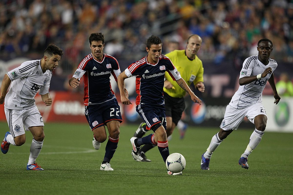 FOXBORO, MA - MAY 12: Benny Feilhaber #22 and Diego Fagundez #14 of the New England Revolution keep the ball away from the Vancouver Whitecaps defense at Gillette Stadium May 12, 2012 in Foxboro, Massachusetts. (Photo by Gail Oskin/Getty Images)