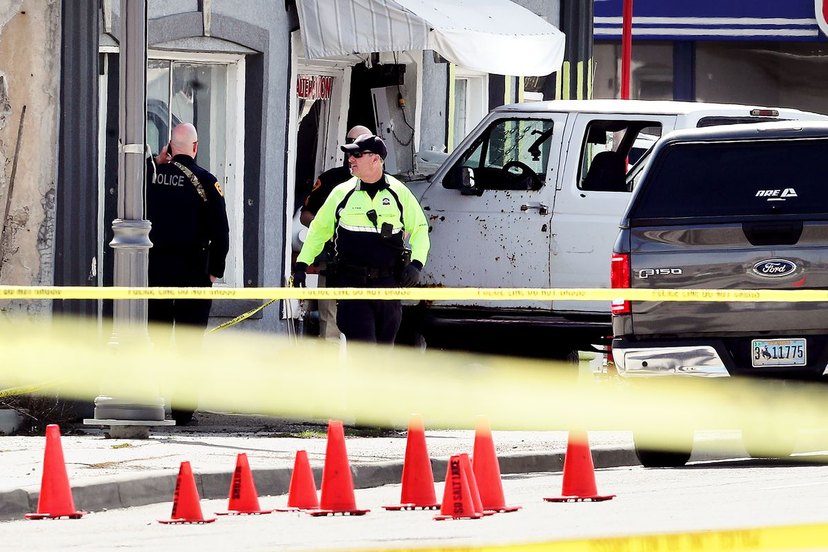 Police investigate after a man driving a white pickup truck crashed into Princess Alterations, 3339 S. State, in South Salt Lake on Monday, April 8, 2019. The driver of the pickup, who was suspected of committing two robberies and who apparently opened fire outside the Sheraton Hotel in downtown Salt Lake City earlier Monday, died after leading police on a chase that ended in a crash and a hail of bullets.