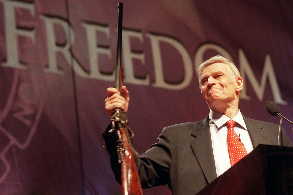 Charlton Heston, former president of the NRA, at the group's convention.  Candice Towell/Getty Images