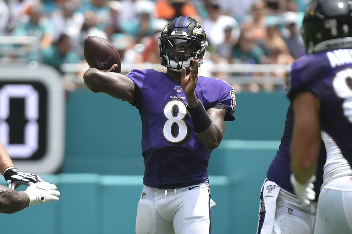 Quarterback Lamar Jackson of the Baltimore Ravens throws a 33 yard touchdown pass to wide receiver Willie Snead in the second quarter against the Miami Dolphins at Hard Rock Stadium on September 8, 2019 in Miami, Florida.