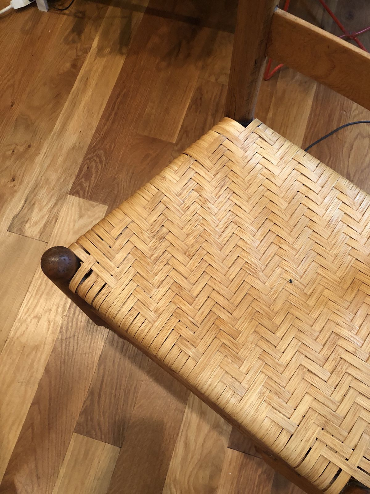 Close-up view of woven cane chair.