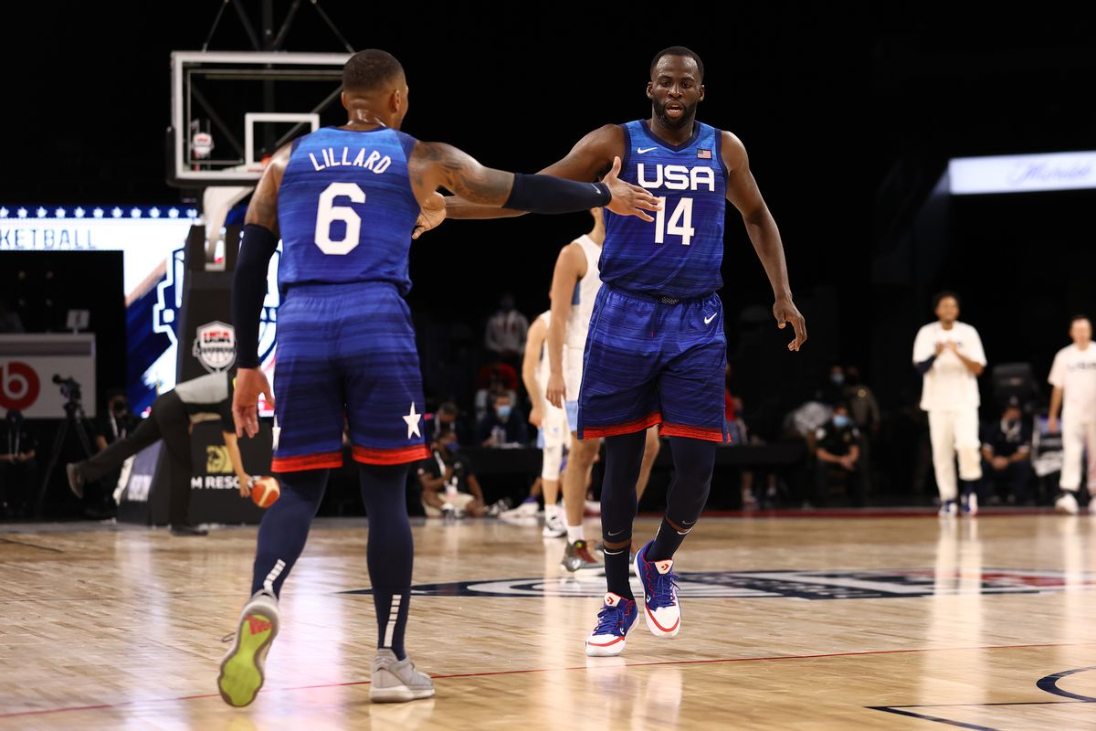 Draymond Green hi-fives Damian Lillard of the USA Men's National Team during the game against the Argentina Men's National Team on July 13, 2021 at Michelob ULTRA Arena in Las Vegas, Nevada.