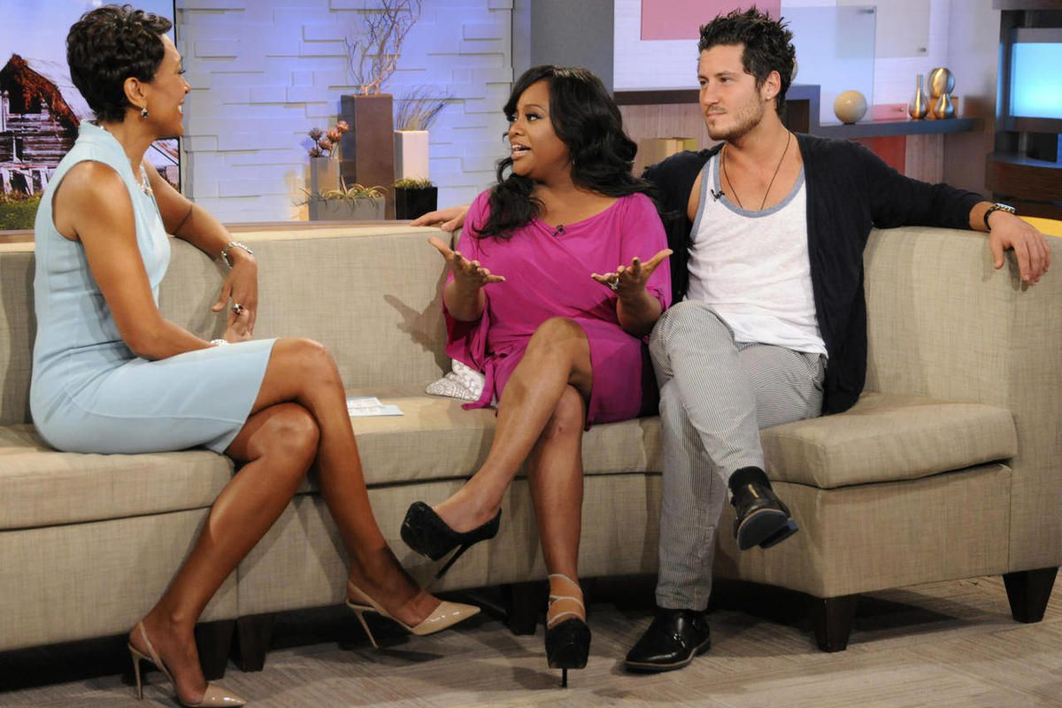 """In this April 11, 2012 photo released by ABC, host Robin Roberts, left, speaks with TV personality Sherri Shepherd and her dance partner Val Chmerkovskiy after they were eliminated from the celebrity dance competition series """"Dancing with the Stars,"""" duri"""
