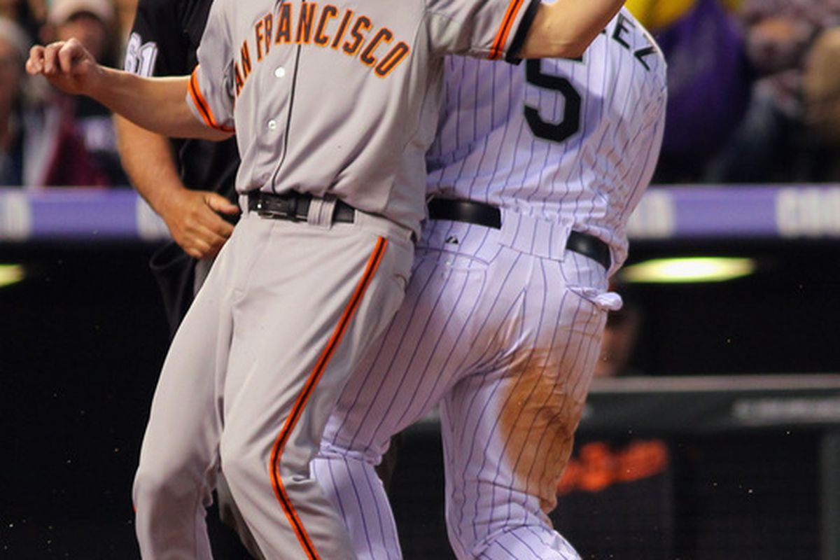 DENVER, CO - APRIL 11: Tim Lincecum #55 of the San Francisco Giants catches a ride out of the stadium on Rockies' outfielder Carlos Gonzalez #5.  (Photo by Doug Pensinger/Getty Images)