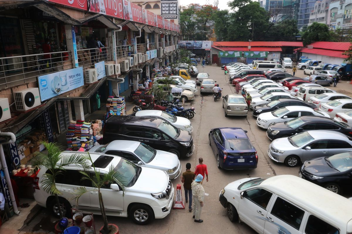 View of a parking lot of a shopping mall full of vehicles on...