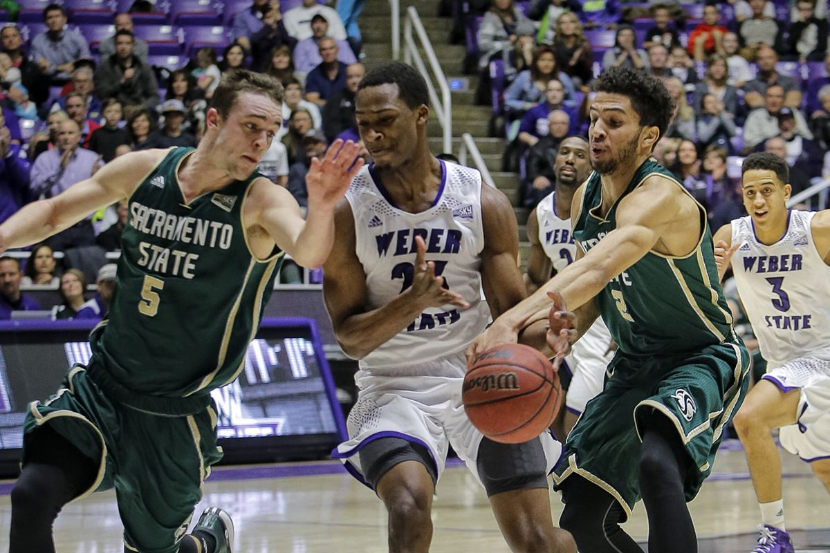 Cody Demps (2) strips Richaud Gittens (23) in Sacramento State's win over Weber State