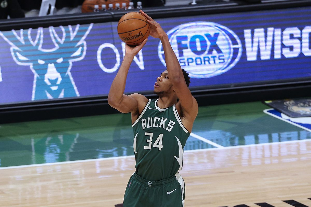Giannis Antetokounmpo of the Milwaukee Bucks attempts a shot in the first quarter against the San Antonio Spurs at the Fiserv Forum on March 20, 2021 in Milwaukee, Wisconsin.