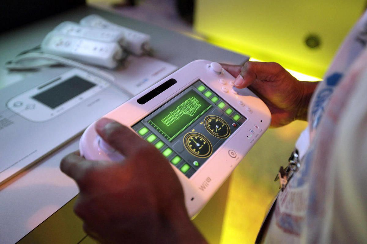An attendee plays a video game using Nintendo's Wii U controller at E3 2012 in Los Angeles, Tuesday, June 5, 2012.