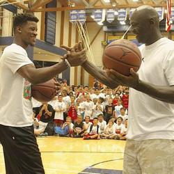 Jimmy Butler (left) and Michael Jordan took shots at Jordan's Flight School in California. | Photo via Instagram