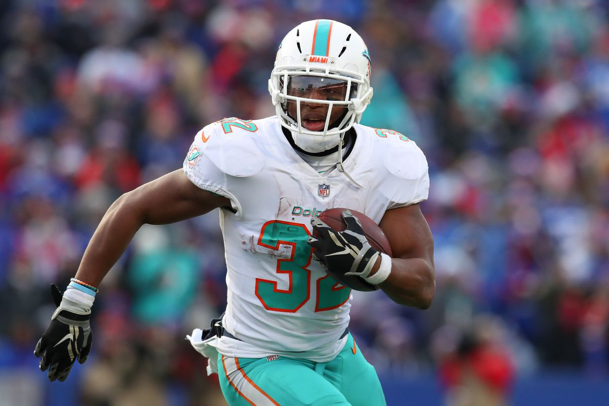 Dolphins running back Kenyan Drake runs with the ball against the Bills at New Era Field.