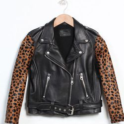 """<b>Laer</b> Shrunken Moto in Black Leather with Cheetah Sleeves, <a href=""""http://therisingstatesnyc.com/"""">$1,025</a> at The Rising States"""