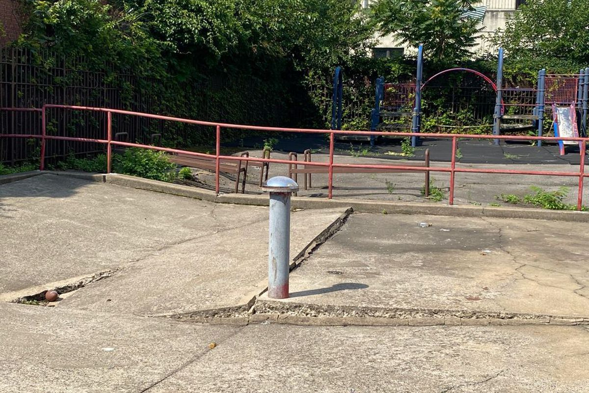A NYCHA playground on Hunts Point Avenue in The Bronx had dangerously uneven concrete, July 19, 2021.