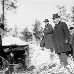 Police surround the dugout in the Indiana Dunes, where the Car Barn Bandits, also known as the Automatic Trio, were found hiding. The photo was taken on Nov. 28, 1903.