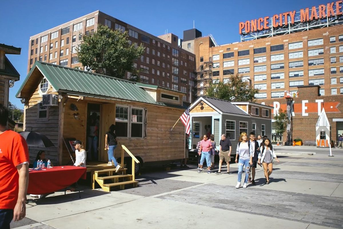 A photo of several tiny houses in the parking lot of Ponce City Market.