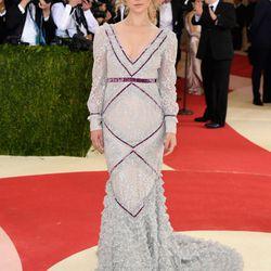 Juno Temple wears an Erdem gown.