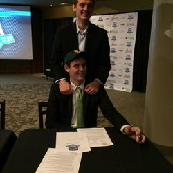 Olympus senior Jake Lindsey signs a basketball scholarship with Baylor University Wednesday at EnergySolutions Arena.