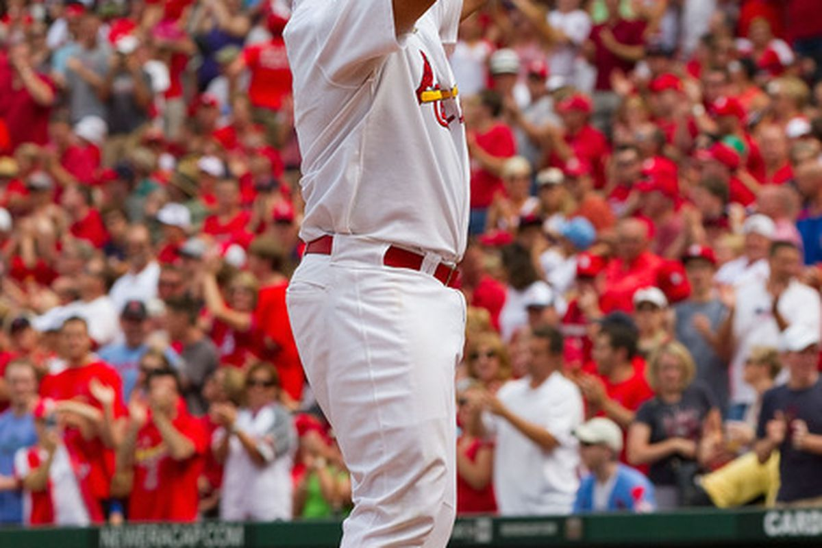 ST. LOUIS, MO - JULY 30: Albert Pujols #5 of the St. Louis Cardinals crosses home plate after hitting a solo home run against the Chicago Cubs at Busch Stadium on July 30, 2011 in St. Louis, Missouri.  (Photo by Dilip Vishwanat/Getty Images)