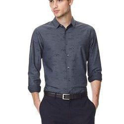 "The <a href=""http://www.theory.com/stephan-black-bird-jacquard-shirt/D0974507,default,pd.html?"">Stephan Shirt</a> ($195—$225) in Black Bird Jacquard (shown)and Sorle Multi"