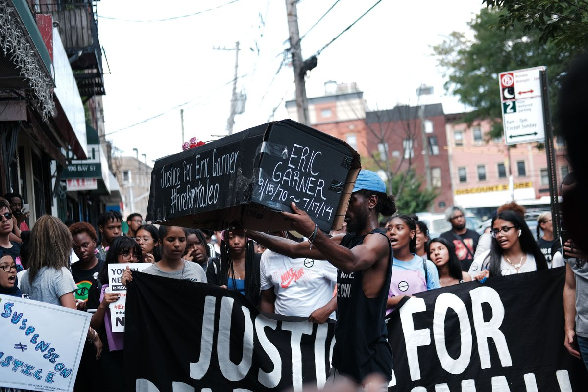 Youth activists in New York City commemorate Eric Garner and Delrawn Small, black men killed during police encounters on August 8, 2019.