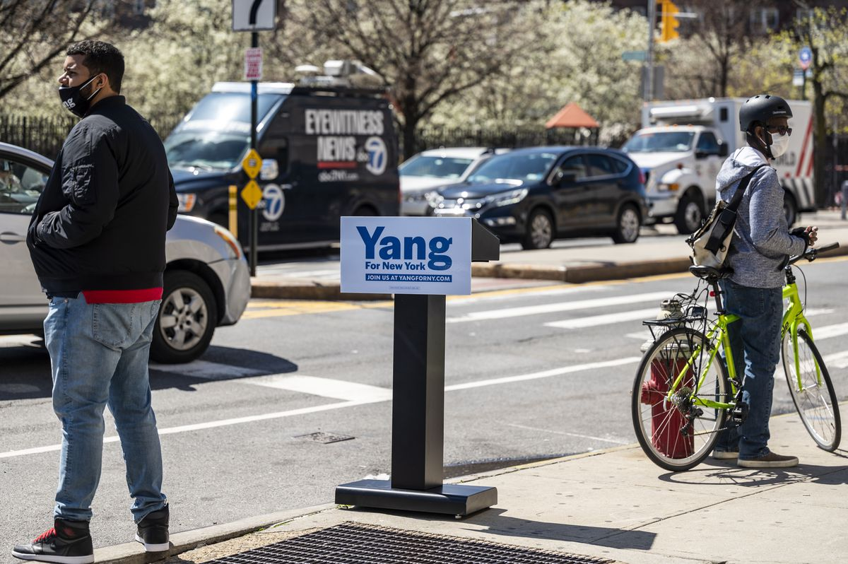 Yang's podium waits for its ride near the curb.